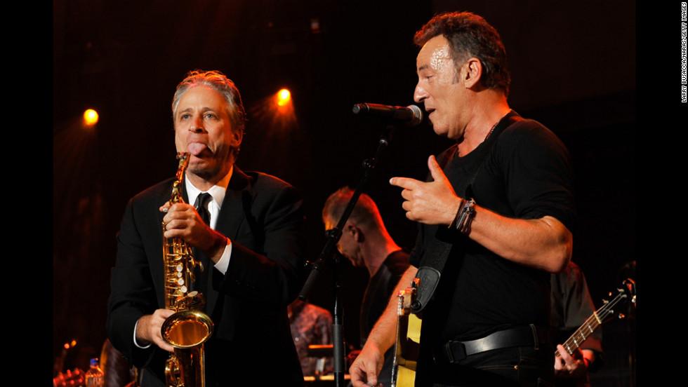 Host John Stewart and Springsteen goof around onstage.
