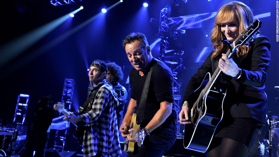 Springsteen and Patti Scialfa perform onstage.