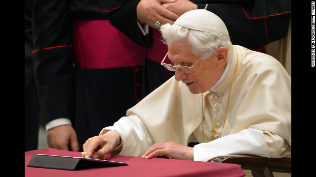 Pope Benedict XVI clicks on a tablet to send his first twitter message during his weekly general audience on December 12, 2012 at the Paul VI hall at the Vatican. Pope Benedict XVI sent his first Twitter message from a digital tablet on Wednesday using the handle @pontifex, blessing his hundreds of thousands of new Internet followers. AFP PHOTO / VINCENZO PINTO        (Photo credit should read VINCENZO PINTO/AFP/Getty Images)