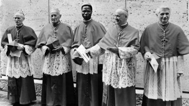 "VATICAN CITY, VATICAN CITY STATE:  Picture dated 07 June 1977 shows German cardinal Joseph Ratzinger (R) at the Vatican city next to Cardinals Benelli (2ndR), Gantin (C), Tomazek (2ndL) and Gappi (L).  German Cardinal Joseph Ratzinger, who was elected 19 April 2005 to succeed Pope John Paul II, was a close confidant of the late pontiff and fellow conservative. The newly elected Pope Benedict XVI, who turned 78 on Saturday, will be expected to maintain John Paul II's deeply conservative line. He has railed against ""greed"" and ""self-sufficiency"" within the Roman Catholic Church and rejects any attempt to modernise. AFP PHOTO FILES  (Photo credit should read STF/AFP/Getty Images)"