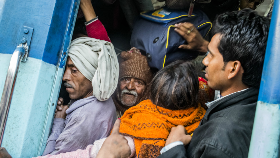 Hindu devotees cram into a train at Allahabad train station during the Maha Kumbh Mela festival on February 11, 2013.