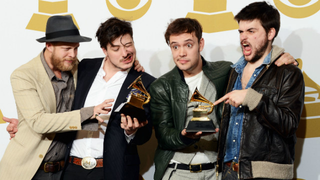 Mumford & Sons, winners of Best Long Form Music Video and Album of the Year, pose in the press room.
