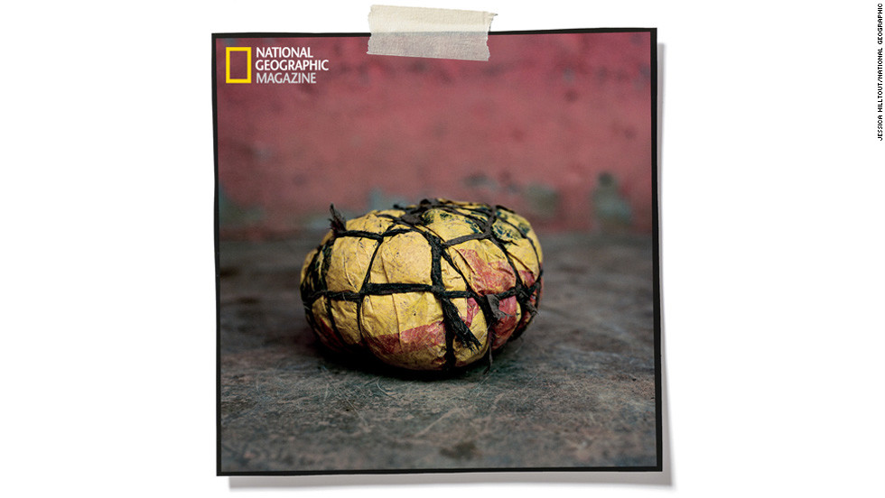 "Bound with rope, plastic bags equal a ball in Bibiani, Ghana. Photographer Jessica Hilltout's<a href=""http://ngm.nationalgeographic.com/2013/soccer-joy/hilltout-photography"" target=""_blank""> complete collection of soccer ball images</a> can be found in the February issue of National Geographic magazine."