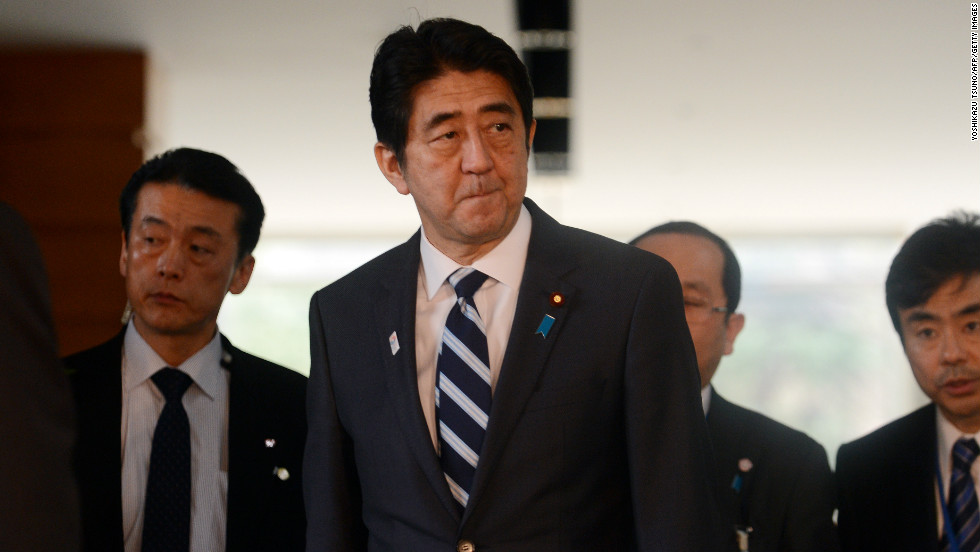 Japanese Prime Minister Shinzo Abe leaves his official residence after he attended the security council meeting in Tokyo on February 12, 2013.
