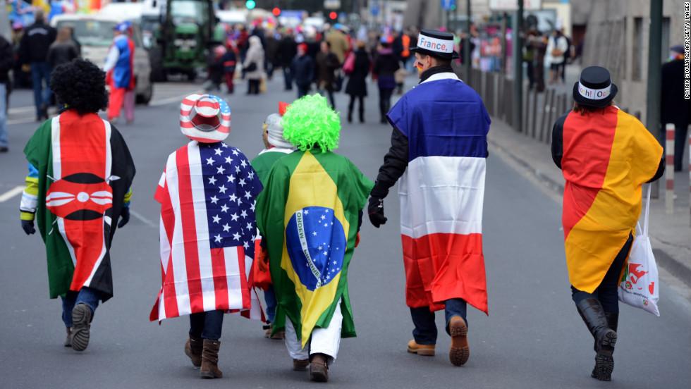 People wearing flags walk in the streets of Düsseldorf.