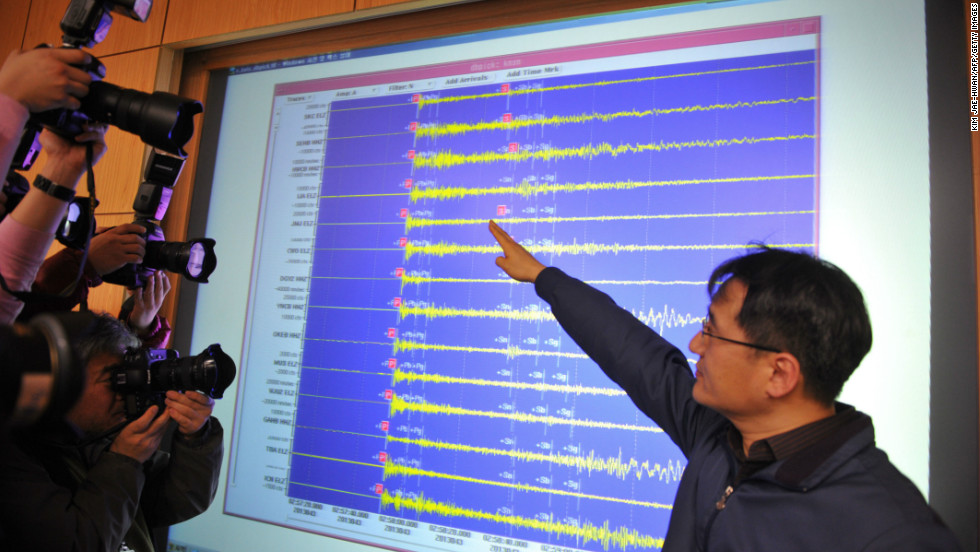 An official of the Korea Meteorological Administration shows a seismic image of a tremor caused by North Korea's nuclear test.