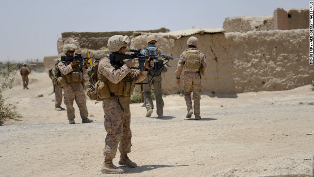 S Marines from Kilo Company of the 3rd Battalion 8th Marines Regiment conduct a patrol in Garmser, Helmand Province on June 27, 2012. The 130,000 NATO troops are due to leave Afghanistan by the end of 2014 and there are fears that their exit will lead to a reduction in rights and freedoms in the war-torn country. AFP PHOTO / ADEK BERRY (Photo credit should read ADEK BERRY/AFP/GettyImages)
