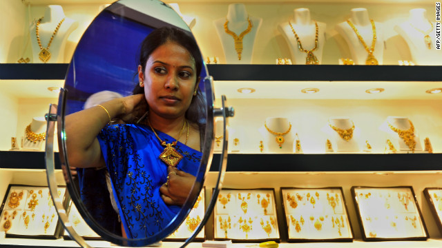 An Indian customer tries on a piece of gold jewellery in Bangalore on October 14, 2011.