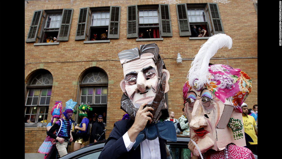 "Nick Mahshie and Anne Devalence, dressed as ""Abe Lincoln and his mistress,"" participate in Mardi Gras celebrations in the Faubourg Marigny."