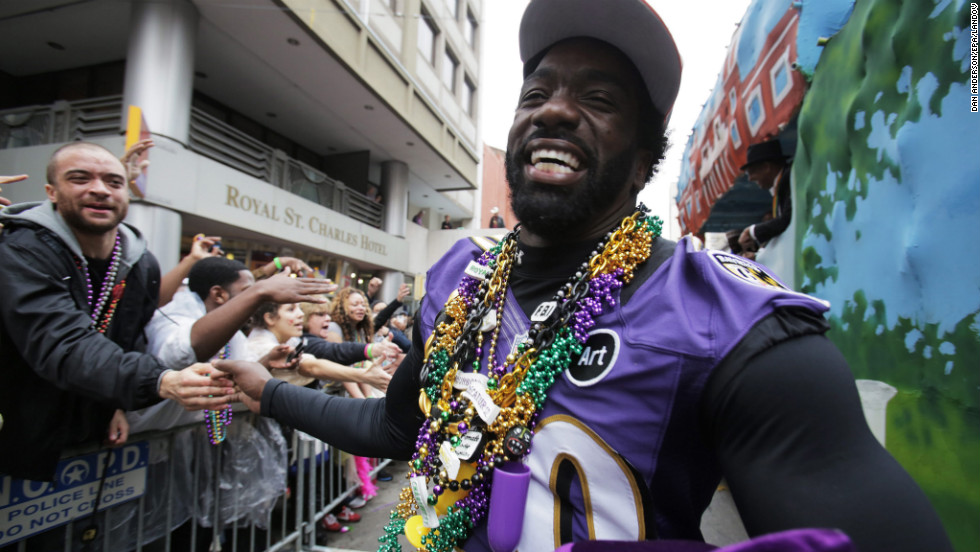 Ed Reed of the Baltimore Ravens walks the parade route after getting off a float during the Krewe of Zulu parade.