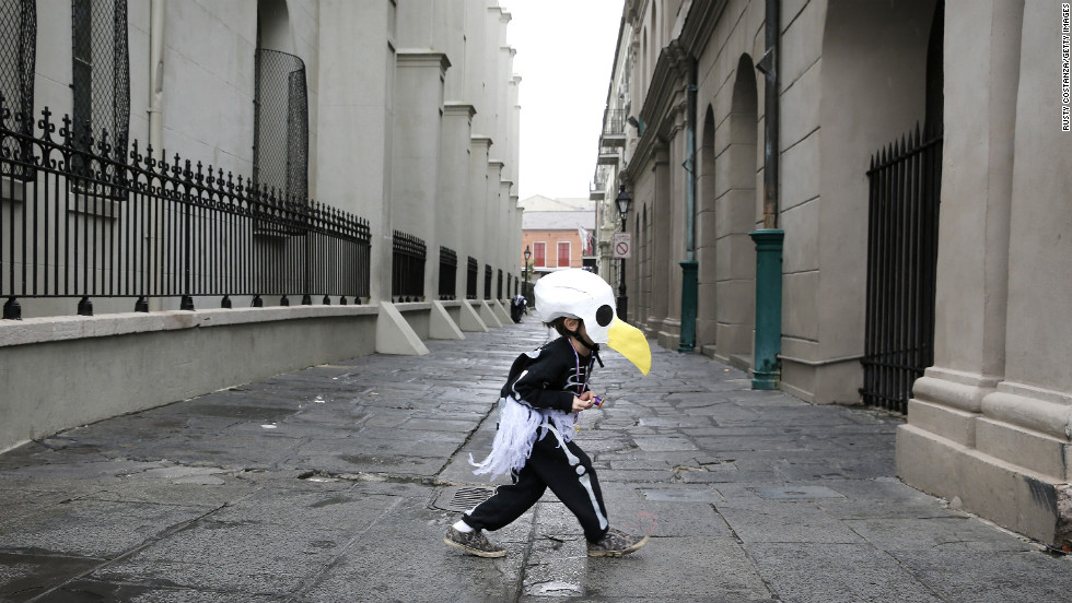 Brody Bell, 6, runs across Pere Antoine Alley dressed as a bald eagle skeleton.