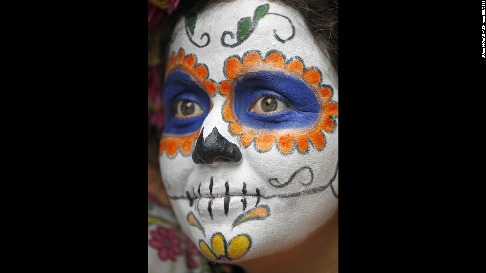Kamil del Toro, dressed as a Day of the Dead sugar skull, participates in celebrations in the French Quarter.