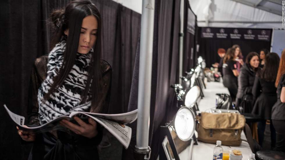 A model reads backstage at the Brandon Sun show on February 13.