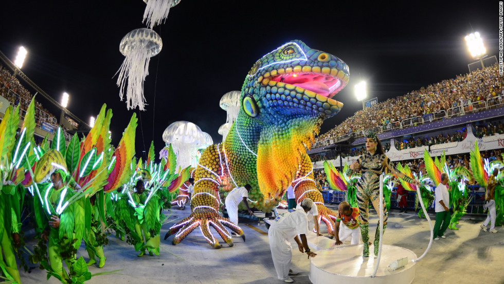 "Among the more colorful processions was this one from the Academicos do Grande Rio samba school. The Sambodromo was built specifically for the parade by famed Brazilian architect, the <a href=""http://edition.cnn.com/2012/12/06/world/americas/brazil-niemeyer-obit"">late Oscar Niemeyer</a>. The venue was inaugurated in 1984 and fits about 90,000 spectators."