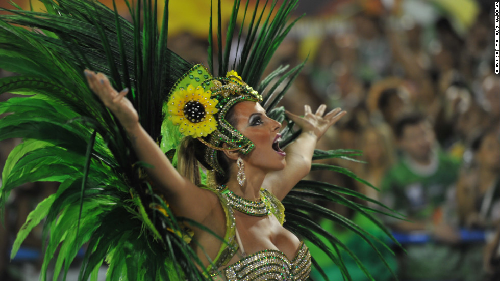 Thousands of performers took part in Rio de Janeiro's Carnival samba parade. The event is famed for its color, dancing, amazing costumes and beautiful performers. Here, a member of the Vila Isabel samba school gets into the spirit.