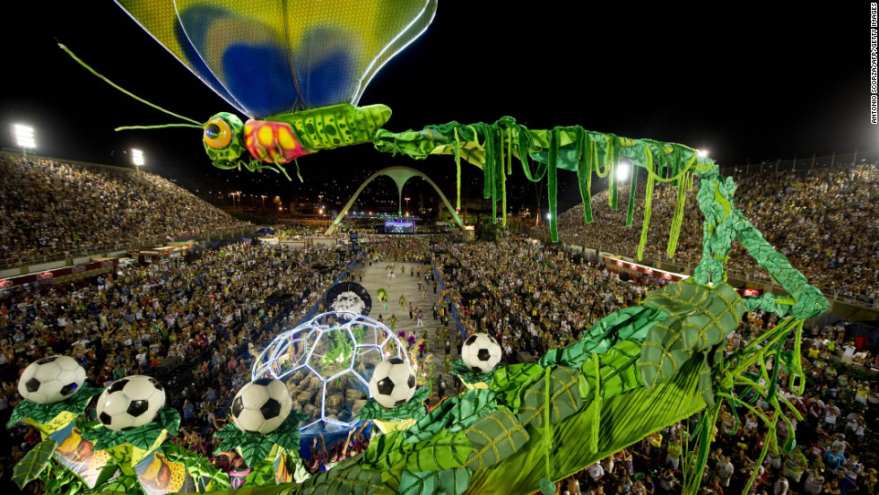 "Somehow, a giant dragonfly and footballs seem entirely suitable at Rio Carnival. This ambitious float didn't fare well, crashing into a TV tower soon after this photo was taken. Though there were no reports of casualties, elsewhere in the country <a href=""http://edition.cnn.com/2013/02/12/world/americas/brazil-carnival-deaths/index.html?hpt=hp_t3"">four people were tragically electrocuted when a float struck power lines</a> in the port city of Santos."