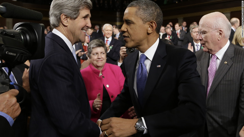 Obama shakes hands with new Secretary of State John Kerry ahead of the State of the Union address.