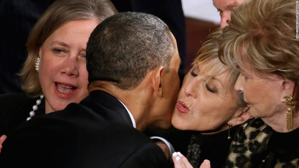 Sen. Barbara Boxer of California kisses Obama as he makes his way to the podium to deliver his address.