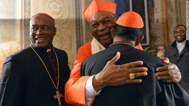 Nigerian cardinal John Onaiyekan (C) greets visitors druing the courtesy visit after being appointed by the pontif on November 24, 2012 at the Apostolico palace at the Vatican.