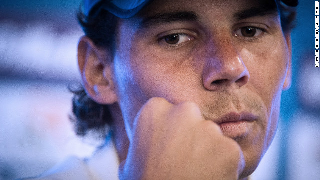 Rafael Nadal returns to the court