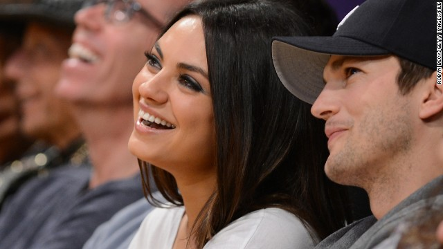 Ashton Kutcher says dads diaper, too!