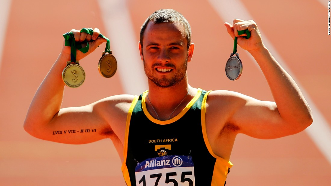Pistorius poses with his medals from the IPC Athletics World Championships in January 2011. He won three world titles there but lost the 100-meter T44 final to Singleton. It was his first loss in a race over 100 meters since the 2004 Paralympic Games.