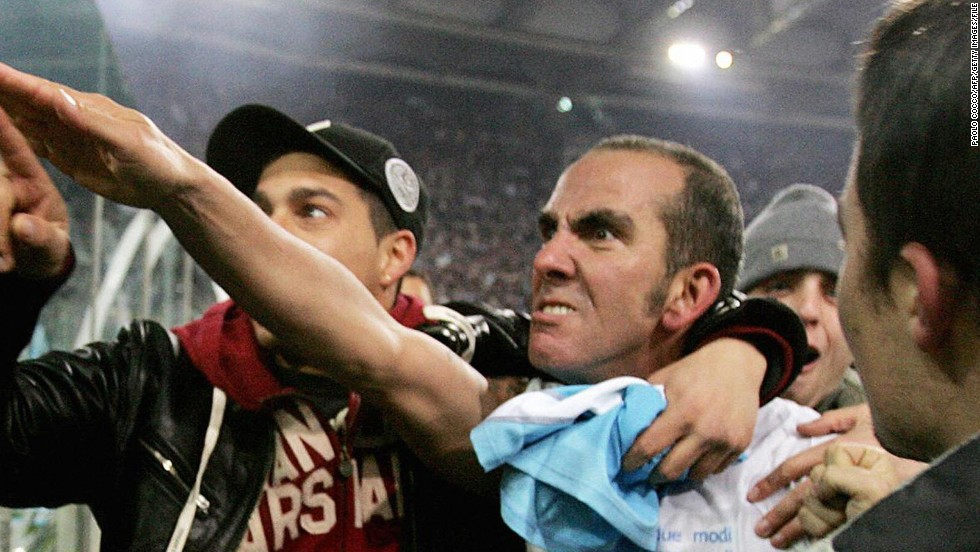 "In 2005 the Italian authorities banned Paolo di Canio -- then playing for Lazio -- and fined him almost $11,000  for his use of a straight-arm salute. ""The sports court decided that it was an act of racism,"" the head of Italy's Observatory on Racism and Anti-racism in Football, Mauro Valeri, told CNN. ""The ordinary court, however, did not intervene. For me it's racism, for the Ministry of the Interior, no."" Di Canio is now manager of English club Swindon Town."