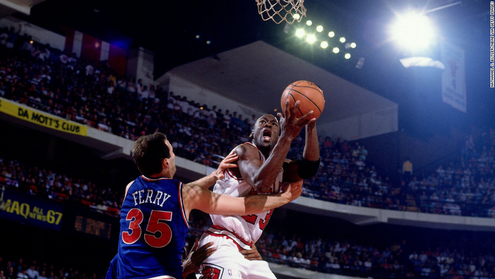 Jordan shoots a layup against Danny Ferry of the Cleveland Cavaliers during a game in 1991.