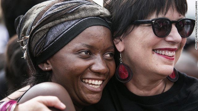 "Image #: 21212719    Eve Ensler (R) founder of V-Day embraces a woman in the crowd during a global rally ""One Billion Rising"", which is part of a V-Day event calling for an end to gender-based violence, in Bukavu February 14, 2013. V-Day is a global activist movement to end violence against women and girls, said organisers. REUTERS/Jana Asenbrennerova  (DEMOCRATIC REPUBLIC OF THE CONGO - Tags: SOCIETY CIVIL UNREST)       REUTERS /STRINGER /LANDOV"
