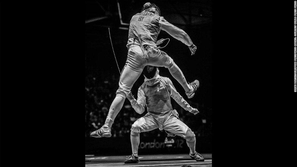 <strong>Second prize sports -- sports action stories: </strong>Egypt's<strong> </strong>Alaaeldin Abouelkassem, top, moves against Peter Joppich of Germany during their men's fencing match on July 31, 2012, during the London Olympics.