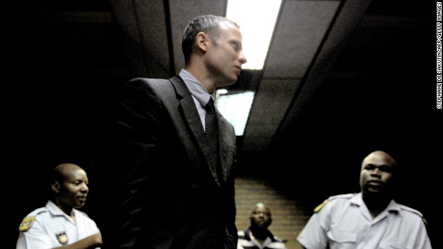 South Africa's Olympic sprinter Oscar Pistorius leaves the court room after his hearing on charge of murdering his model girlfriend Reeva Steenkamp on Valentine's Day, yesterday, on February 15, 2013 at the Magistrate Court in Pretoria. South African prosecutors will argue that Pistorius is guilty of premeditated murder in Steenkamp's death, a charge which could carry a life sentence.       AFP PHOTO / STEPHANE DE SAKUTIN        (Photo credit should read STEPHANE DE SAKUTIN/AFP/Getty Images)