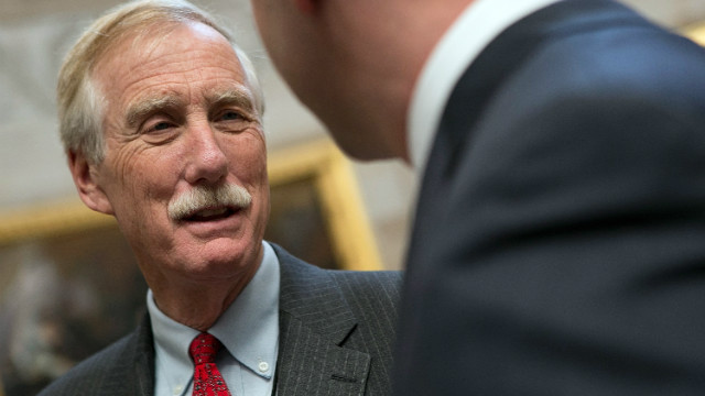 Sen.-elect Angus King, I-Maine, speaks to members of his staff at the U.S. Capitol after being elected last year.