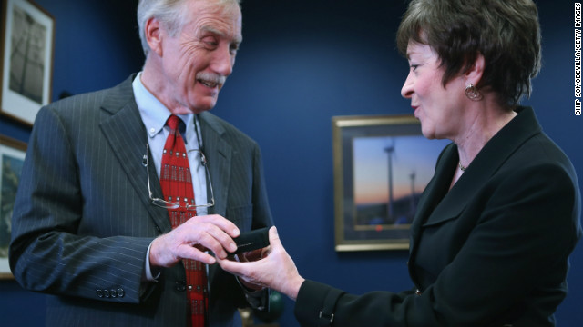Sen. Susan Collins, R-Maine, presents Sen.-elect Angus King with Senate cufflinks in Collins' Capitol Hill office.