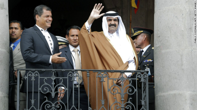 Ecuadorian President Rafael Correa hosted Qatar's Emir Hamad Bin Khalifa Al-Thani, waving, in Quito Saturday.