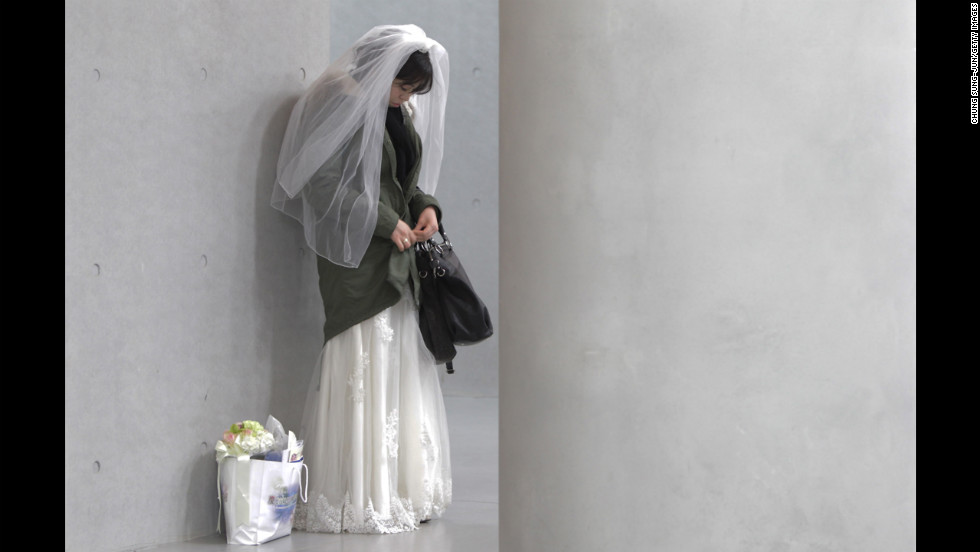 A bride waits for her wedding ceremony  to begin.