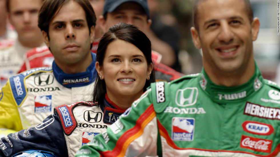 From left: Vitor Meira, Patrick and Tony Kanaan pose for a photograph in 2005 in Times Square.