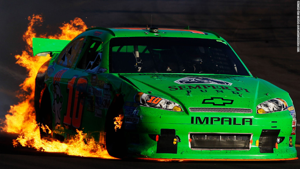 Patrick drives as flames shoot from the back of her car after an incident in the AdvoCare 500 in 2012 in Avondale, Arizona.