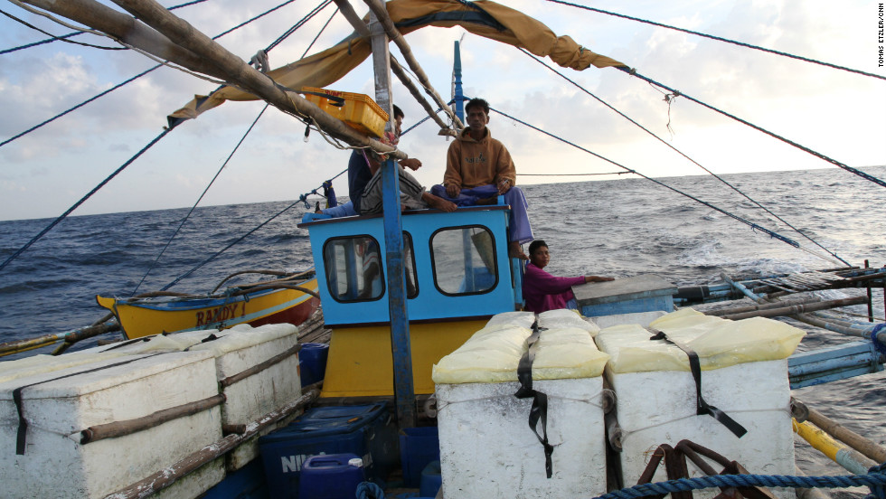 Efren Forones (center) and his fellow fishermen embark on the 38-hour trip to fishing grounds around the disputed Scarborough Shoal.