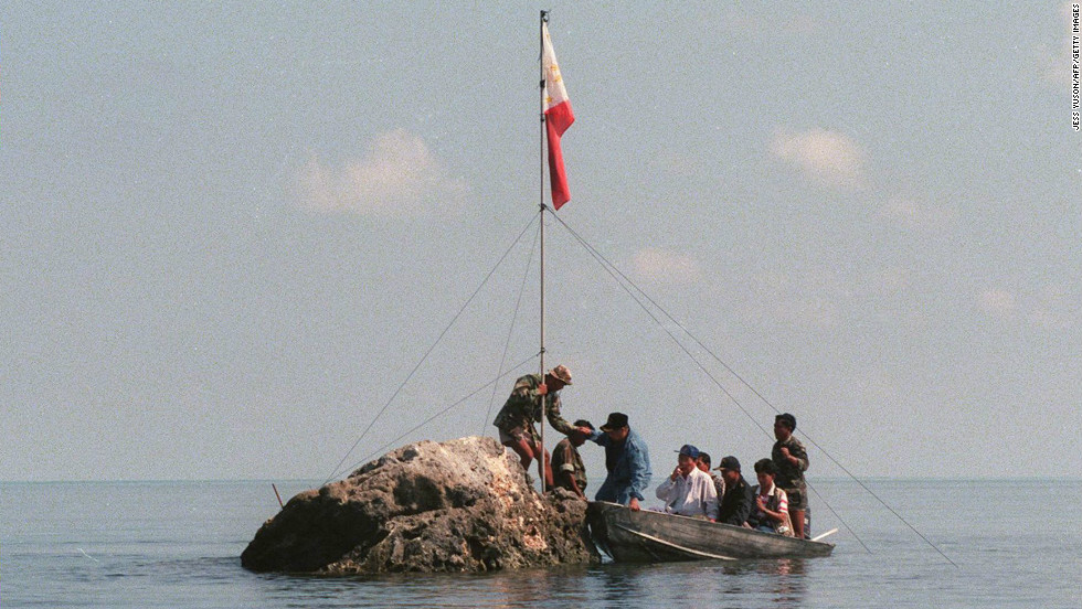 And this is what it's all about: A team of lawmakers plant a Philippines flag on a tiny rock at the Scarborough Shoal on May 17 last year.