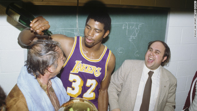 PHILADELPHIA - MAY 16: Magic Johnson #32 of the Los Angeles Lakers pours a bottle of champagne over the owner of the Lakers Jerry Buss after winning Game 6 of the 1980 finals and defeating the Philadelphia 76ers four games to two during the 1979-80 NBA Championships on  May 16, 1980 at the Spectrum in Philadelphia, Pennsylvania.  The Lakers defeated the 76ers 123-107 to win the series. (Photo by Focus on Sport/Getty Images)