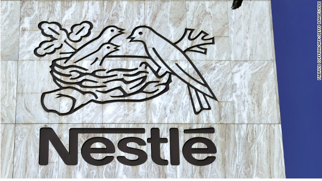A crow flies above a sign of the world's biggest food company Nestle at their headquarters on August 10, 2011 in Vevey.