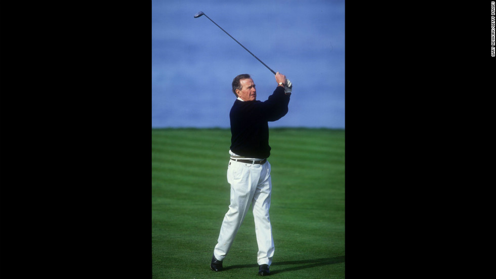 President George H. W. Bush tees off on the fourth hole at Spyglass Golf Course during the AT&T Pebble Beach National Pro-Am on February 28, 1994, in Pebble Beach, California.