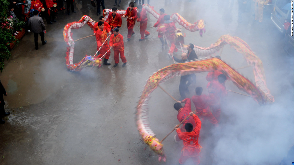People join in a dragon dance to celebrate the Chinese New Year on Monday, February 18, in Quanzhou County, China.