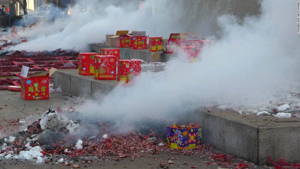 Firecrackers smoke during a firework display in Shenyang, China, on Saturday, February 16.