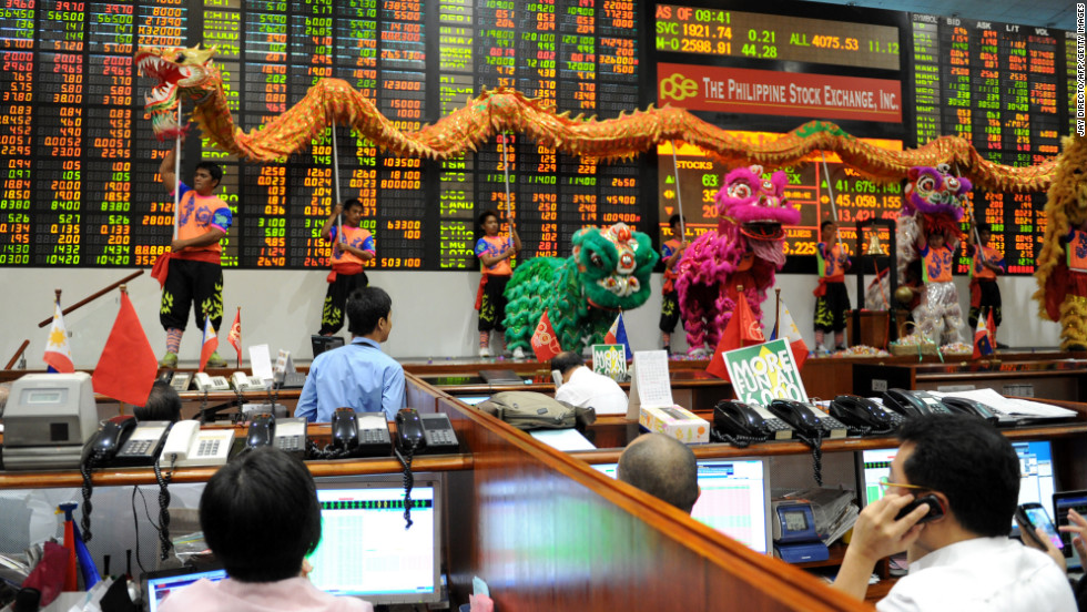 Performers take part in a dragon and lion dance at the Philippine Stock Exchange to mark the start of the first day of trading in the Chinese Year of the Snake in Manila, Philippines, on Monday, February 11.