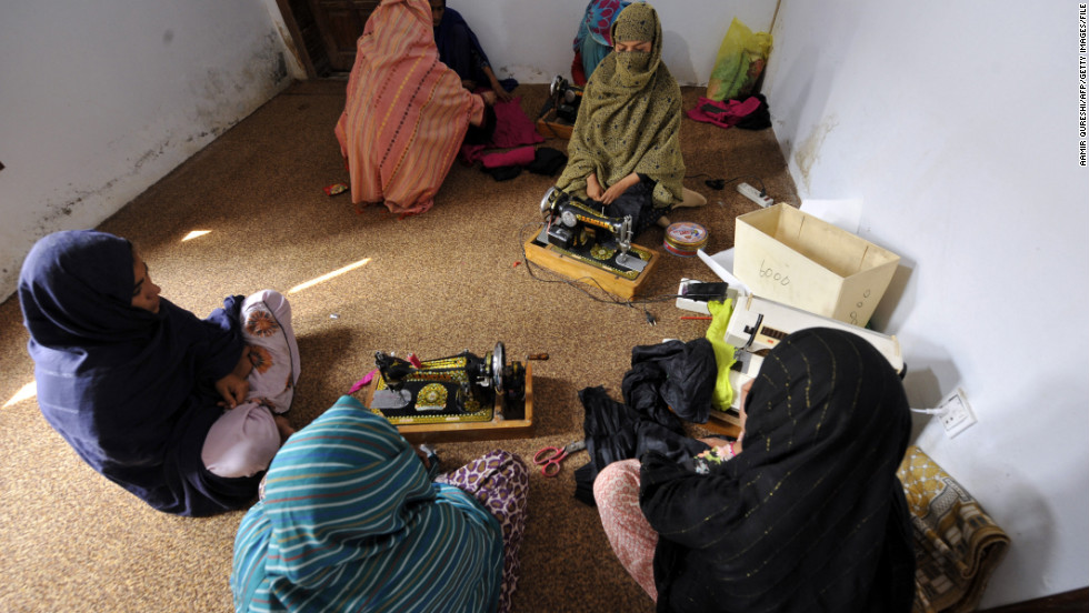 This photograph taken on February 28, 2011, shows women sitting at a vocational training center for women in a shelter set up by Mukhtar Mai to protect women in the village of Mirwala in Pakistan's central Punjab province.