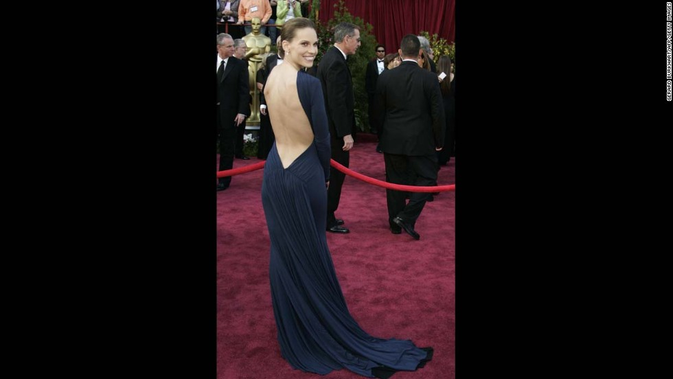 "Hilary Swank turned heads in a backless dress by Guy Laroche in 2005, the year she won the Oscar for her role in ""Million Dollar Baby."""