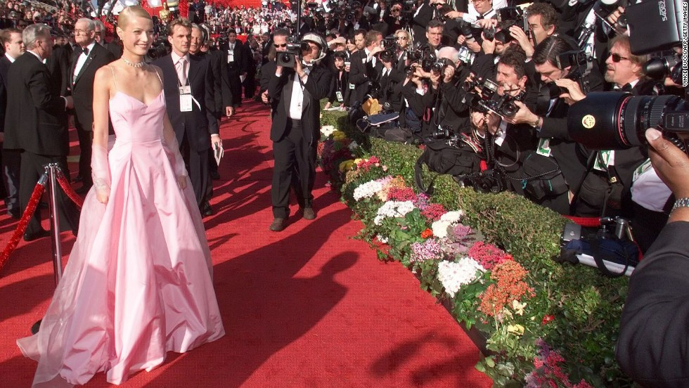 The Ralph Lauren gown Gwyneth Paltrow wore to the Oscars in 1999 is credited with making the color pink fashionable again. The dress received mixed reviews from critics, but it's still one of the most recognizable looks ever on the red carpet.