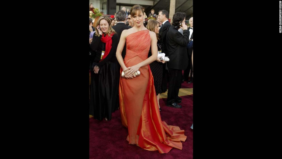 "Jennifer Garner wore a memorable tangerine gown at the 2004 Academy Awards. ""Jennifer is so comfortable in her own skin, she can wear a gown this complex,"" designer Valentino said."