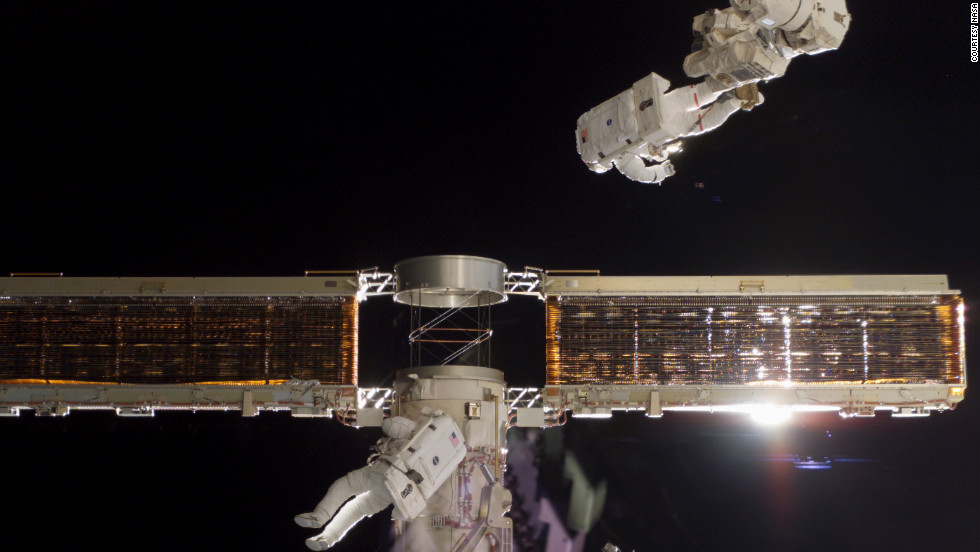 The Endeavour crew installs the first set of U.S. solar arrays on the station in 2000.